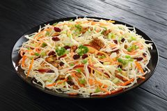 Tasty Apple Cranberry and walnuts Coleslaw. Delicious healthy Apple Cranberry and walnuts Coleslaw salad covered in a lighter Greek yogurt dressing on a black royalty free stock photo