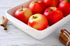 Tasty apples in baking bowl on wooden boards Royalty Free Stock Photography