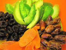 Tasty colorful dried fruits in green plate royalty free stock photography