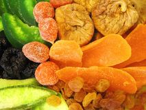 Tasty colorful dried fruits in green plate stock photography