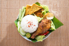 Tasty Asian food nasi ayam penyet. Popular delicious Indonesian local food nasi ayam penyet, indonesian fried chicken rice with sambal belacan. Fresh hot with royalty free stock photography