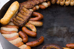 Tasty assortment of hot grilled sausages Royalty Free Stock Images