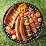 Tasty assortment of meat on a summer barbecue Royalty Free Stock Photography