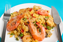 Tasty Authentic Paella on Blue Background Royalty Free Stock Photography