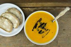Tasty autumn starter of cream of pumpkin soup Stock Photos