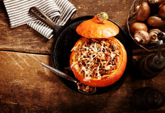 Tasty autumn stuffed pumpkin with mushrooms Royalty Free Stock Images