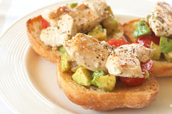 Tasty avocado, tomato and chicken bruschetta. Tasty avocado, baby tomato and grilled chicken bruschetta on ciabatta Stock Photos