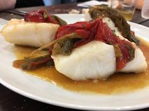 A tasty bacalao a la vasca cod fish stock photography