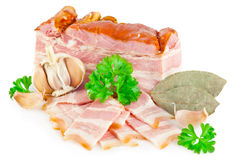 Tasty bacon with laurel, parsley and garlic royalty free stock photos