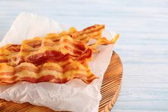 Tasty bacon slices. On wooden board Stock Photos