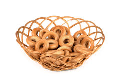 Tasty bagels in basket Stock Image
