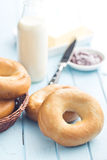 Tasty bagels on kitchen table Royalty Free Stock Photo