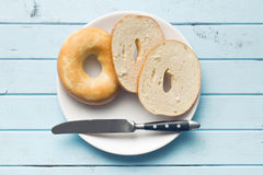 Tasty bagels on plate Royalty Free Stock Photos