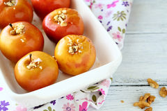 Tasty Baked apples in a baking dish Royalty Free Stock Photos