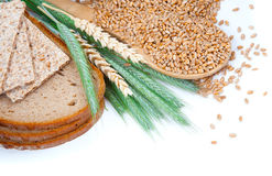 Tasty baked bread with ears and wheat grain Stock Image
