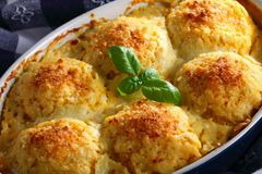 Tasty baked dumplings stuffed with ragout Stock Photo