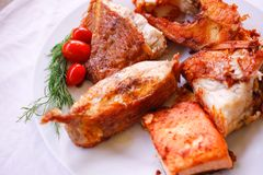 Tasty baked fish with cherry tomatoes and fresh Stock Images