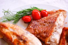 Tasty baked fish with cherry tomatoes and fresh Stock Photos