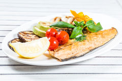Tasty baked fish Stock Images