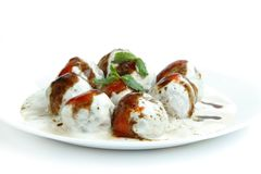 Tasty banana dahi vada kept in a plate Stock Photos