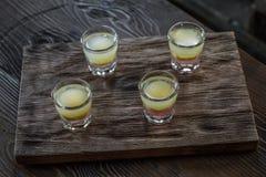 Tasty bar alcoholic shots. Mix cocktail & wood Royalty Free Stock Images