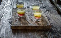 Tasty bar alcoholic shots. Mix cocktail & wood Stock Image