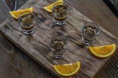 Tasty bar alcoholic shots. Mix cocktail & wood Stock Photo