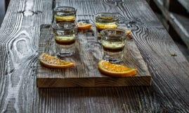 Tasty bar alcoholic shots. Mix cocktail & wood Stock Photography