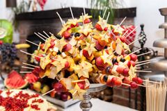 Appetizers on skewers in silver bowl stock image