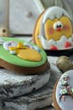 Tasty beautiful easter gingerbread cookies on a white wooden surface. Holiday bright Easter. Preparing for a religious holiday.  stock photos