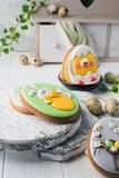 Tasty beautiful easter gingerbread cookies on a white wooden surface. Holiday bright Easter. Preparing for a religious holiday.  royalty free stock photography