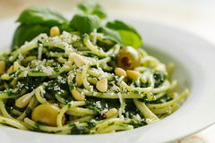 Tasty Beautiful Pasta Closeup with Spinach, Cheese, Olives, Basi Stock Image