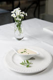 Tasty Bechamel sauce or white, with fresh greenery. Tasty Bechamel sauce or white sauce with fresh greenery stock photo