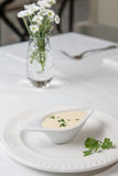 Tasty Bechamel sauce or white sauce with fresh greenery.  stock image