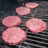Tasty beef burgers on the grill Stock Photo