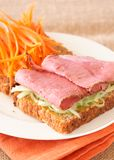 Tasty beef sandwich on wholewheat bread Stock Images