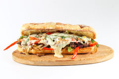 Tasty beef steak sandwich with onions, mushroom and melted provolone cheese Royalty Free Stock Photo