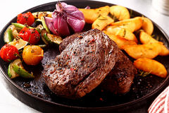 Tasty Beef Steak with Vegetables on Skillet Stock Image