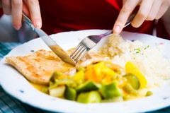 Tasty beefsteak closeup. Young woman eating beefsteak royalty free stock photo