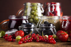 Tasty berry and fruit jam and berry. Fruit jamand, Set of glass jars Royalty Free Stock Images