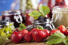 Tasty berry and fruit jam and berry Stock Images