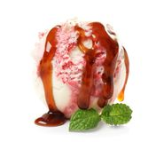 Tasty berry ice-cream ball with caramel topping. On white background Royalty Free Stock Photo