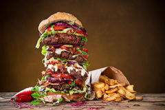 Tasty big burger on wooden table. stock images
