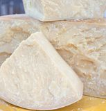 Tasty big seasoned Italian cheese for sale in dairy Royalty Free Stock Photo