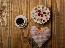 Tasty biscuit and heart pillow Royalty Free Stock Images