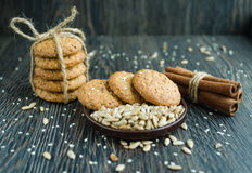 Tasty biscuits in cereal and cinnamon on wood background Royalty Free Stock Photo