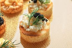 Tasty black caviar appetizer Stock Images