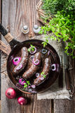 Tasty black pudding on pan Stock Image