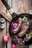 Tasty black pudding with parsley and onion Royalty Free Stock Image