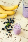 Tasty blueberry smoothie in bottle royalty free stock photography